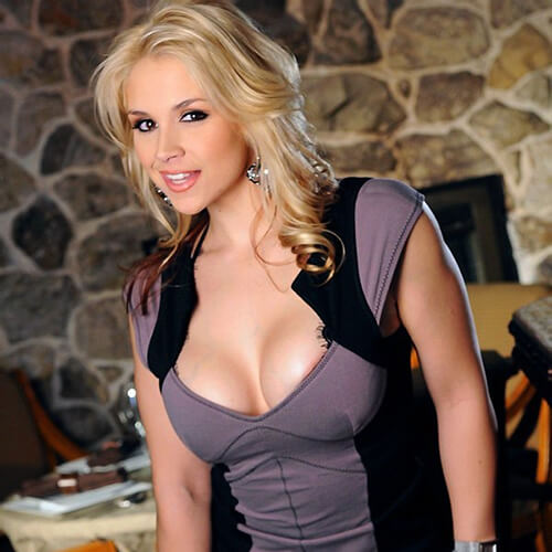 Sarah Vandella showing big tits in purple dress